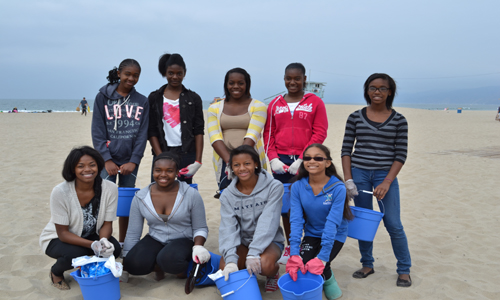 The girls learn a lesson in environmental stewardship at Coastal Clean Up at Santa Monica Beach